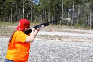 Photo by Kevin Spradlin | PeeDeePost.com Sidney Hughes, 17, of the Bunker Hill Hunter Safety Team from Catawba, takes her turn on the 12-gauge shotgun firing range.