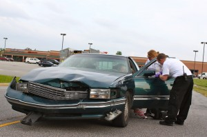 Kevin Spradlin | PeeDeePost.com This green Cadillac sedan suffered significant front-end damage after it and a gray Toyota SUV collided.