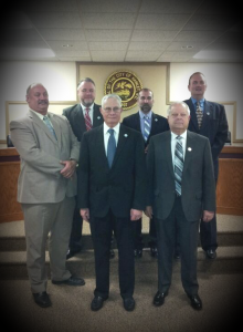 Photo courtesy city of  Hamlet Mayor Bill Bayless, front center, and City Council members Tony Clewis, Pat Preslar, Johnathan Buie, Eddie Martin and Jesse McQueen are charged with balancing a budget by either using more than $820,000 from the fund balance, cutting at least $500,000 from the proposed budget or raising taxes.