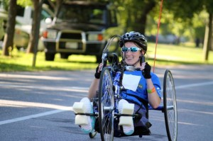 Kevin Spradlin | PeeDeePost.com Kandace Frye, 22, of Rockingham, completes her first 5K using a hand cycle on Saturday at the 3rd annual Cordova 5K. It was Frye's first race since being paralyzed from the mid-chest down as a result of a January car accident.