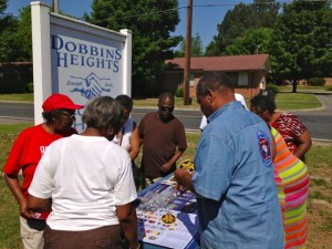 Kevin Spradlin | PeeDeePost.com Attendees of the Memorial Day program at Dobbins Heights Town Hall visit a table of brochures about the U.S. of America Vietnam War Commemoration. The town is a partner with the Commemorative Partner Program and is required to stage two events each year that honor Vietnam veterans.