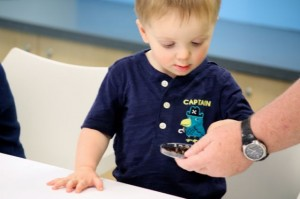Kevin Spradlin | PeeDeepost.com Gabriel Phillips, 2, of Clinton, Md., observes some worms Sunday afternoon at Discovery Place KIDS.