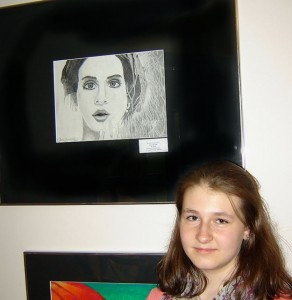 "Submitted photo Nicole Lawrence poses beside ""It's in the eyes,"" a pencil drawing."
