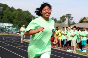 Kevin Spradlin | PeeDeePost.com Olinda Hernandez sprints down the track before a crowd of cheering fans Friday at Raider Stadium during the Richmond County Special Olympics Spring Games.