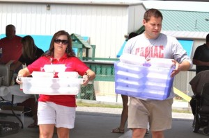 Kevin Spradlin | PeeDeePost.com Sandhills Children's Center Director Melanie Carnes, left and Assistant Director Justin Clark help load and deliver plates to nearby business.