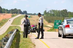 Kevin Spradlin | PeeDeePost.com North Carolina Highway Patrol troopers evaluate the scene of a one-vehicle motorcycle crash mid-Sunday afternoon on U.S. Route 220 south of Ellerbe.