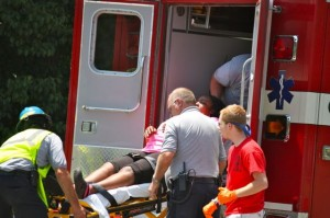Kevin Spradlin   PeeDeePost.com An injured woman is assisted into the back of a Cordova Fire & Rescue ambulance en route to FirstHealth Richmond Memorial Hospital.