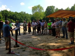Kevin Spradlin | PeeDeePost.com Rockingham City Manager Monty Crump, left, addresses the crowd of local leaders and dignitaries, many of whom played a role, large or small, in the transformation of Hitchcock Creek.