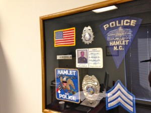 Kevin Spradlin | PeeDeePost.com The ID card  Hamlet Police Chief Amery Griffin wore when he first joined the force in February 1986 hang framed in his office, along with his sergeant stripes and modern badge.