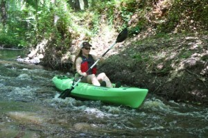 Kevin Spradlin | PeeDeePost.com Erin Singer McCombs, of American Rivers, navigates a rough patch with ease during a Tuesday afternoon kayaking trip along Hitchcock Creek.