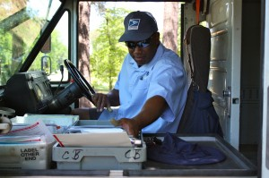 Kevin Spradlin | PeeDeePost.com Letter carrier Edward Ash sorts mail in his truck while on his delivery route along Richmond Road. Letter carries will collect nonperishable food items Saturday, May 10 during their normal delivery times and give those items to Our Daily Bread Food Bank in Rockingham.