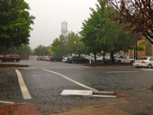 Kevin Spradlin   PeeDeePost.com Rain and winds knocked down a promotional sign outside Henry's Uptown Cafe early Thursday afternoon on South Hancock Street in downtown Rockingham.