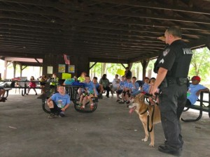 Kevin Spradlin | PeeDeePost.com Sgt. A. Ansley and K9 Officer Leica talk with local scouts Tuesday morning at East Rockingham Park.