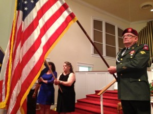 Kevin Spradlin | PeeDeePost.com Army veteran Ron Mayo caps the presentation of the 50 flags of the United States with the American flag.