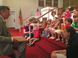 Kevin Spradlin | PeeDeePost.com Pastor Randy Bishop talks with children on Sunday about the importance of celebrating America's birthday.