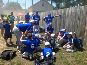 Kevin Spradlin | PeeDeePost.com Coach Mike Eason, seated in center, talks with his players after the team's 11-8 loss on Sunday to West Raleigh.