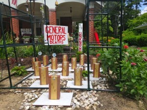 Kevin Spradlin | PeeDeePost.com Rockingham resident Kathy Phillips, 60, erected this symbolic mock cemetery in her front yard to protest the actions of General Motors.