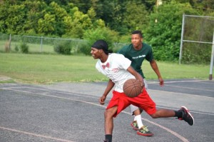 Kevin Spradlin | PeeDeePost.com Quentin Gore, in green, allows Tu'Quan Breeden to dribble around him in a friendly hoops session Thursday at Dobbins Heights Community Park.