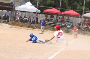 Kevin Spradlin | PeeDeePost.com A little short. Talon Stoner had a two-run single in the bottom of the fifth but was out on this slide into third.