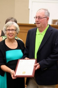 Kevin Spradlin | PeeDeePost.com Former County Commissioner Jimmy Maske and his wife, Peggy, accept a plaque from the current commissioners. Maske resigned, effective May 31, for health reasons.