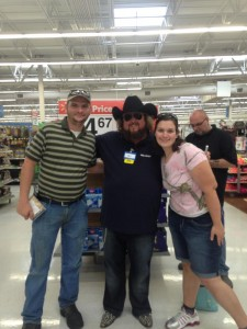 PeeDeePost.com columnist Jennifer Ferguson poses with country music artist Colt Ford. Tuesday night at Walmart in Monroe.
