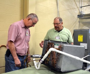 A Richmond Community College photo RCC instructor Bill Frye, right, works with Billy Deaver of Hamlet during a class for the Air Conditioning, Heating and Refrigeration Technology program at RCC. The College will hold several information sessions about its trade programs this summer.