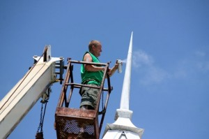 Kevin Spradlin | PeeDeePost.com Richard Schoonover puts the finishing touches on the steeple at Mt. Zion Methodist Church Tuesday afternoon in Rockingham.