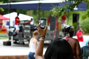 Kevin Spradlin | PeeDeePost.com Whatever's worth watching once is worth watching twice. This fan records a part of Thursday night's Plaza Jam to share later on.