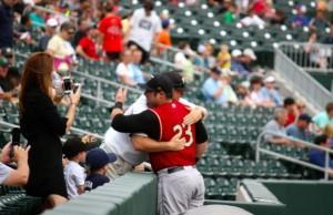 Kevin Spradlin | PeeDeePost.com Kyle Roller and former Raiders baseball coach Trent Mangero meet before Sunday's game in Charlotte.