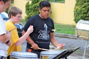 Kevin Spradlin | PeeDeePost.com Angelis Hernandez assists Cameron Mabe, left, and Cameron McDonald on the snare drums Wednesday during percussion camp at Richmond Senior High School.