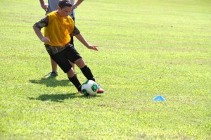 Kevin Spradlin | PeeDeePost.com Austin Campbell, 10, works on dribbling during soccer tryouts Saturday in Hamlet.