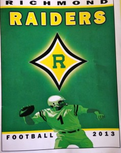 The 2014 football program will include a photo of the Raiders Marching Band.