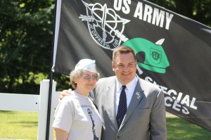 Kevin Spradlin | PeeDeePost.com Mary O'Neal poses with U.S. Rep. Richard Hudson during the Memorial Day observance in May at Richmond County Veterans Memorial Park in Rockingham. The pair stand in front of the Special Forces banner. O'Neal's late husband served as Special Forces commander.