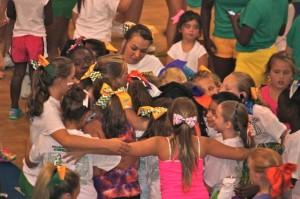 Kevin Spradlin | PeeDeePost.com Cheerleaders huddle to say goodbye at the end of the Richmond Raiders Cheer Camp on Thursday at Richmond Senior High School.