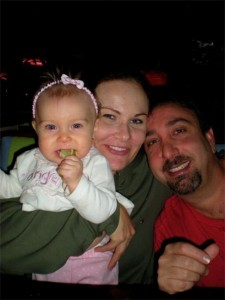 "Brett Cavaliero, wife Kristie Reeves-Cavaliero and, left, Sophia ""Ray-Ray"" Cavaliero, who died in May 2011 at the age of 1 after being left in a vehicle unattended for several hours."