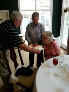 Submitted photo Former Hoffman High School students Andy Jenkins, left, and Don Bryant hold the cake for Betty C. Yount, was was surprised with a surprised birthday luncheon and being awarded the Order of the Long Leaf Pine by the Governor's Office.