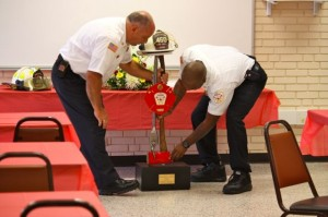 Kevin Spradlin | PeeDeePost.com Fire Chief Charles Gardner and his successor, Harold Isler, put into place a series of farewell gifts symbolic of Gardner's career in the fire service.