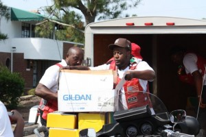 Kevin Spradlin | PeeDeePost.com Volunteers and members of Playaz Elite MC unload a trailer full of school supplies and deliver them on Friday to Monroe Avenue Elementary School in Hamlet.