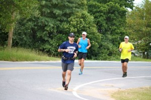Kevin Spradlin | PeeDeePost.com Duke Smith (left) and Mark Long (in yellow) finish up the 10K loop while Jimmy Arnold (center) completes miles 7 and 8 during a course recon of the GNAT Scat 10K event in Norman.