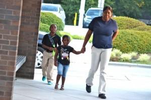 Kevin Spradlin | PeeDeePost.com Ebony Stewart walks her son, Chrostopher Ingram, 7, into Washington Street Elementary School Monday morning with little sister Emani Ingram, 3, in tow.