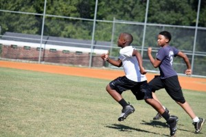 Kevin Spradlin | PeeDeePost.com Seventh-grader Omarion Brown, left, hustles during wind sprints on Tuesday at the first day of tryouts for the Rockingham Middle School football team.