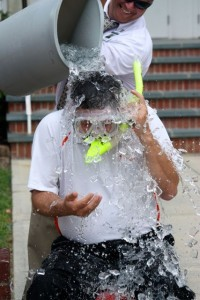 Stephanie Spradlin   PeeDeePost.com Assistant Principal Kevin Wallace smiles as he dumps a lot of ice-cold water onto his boss, Rockingham Middle School Principal Julian Carter.