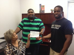 Submitted photo Chris Clark and Michael McRae receive their approved permit from Rockingham City Clerk Gwen Swinney Thursday at City Hall.