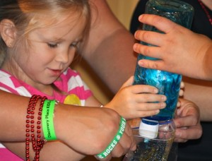 Kevin Spradlin   PeeDeePost.com Led by Discovery Place KIDS staff member Jordyn Chance, 5-year-old Kennidy Taylor, of Rockingham, learns about primary colors and what happens when you mix 'em.
