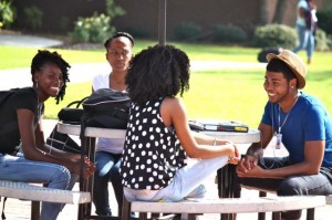 Kevin Spradlin | PeeDeePost.com Ny-asia Smith (center), Yianah Newkirk (left), Lakeya Cooper and William McLaughlin hang out in the quad between classes on Monday at Richmond Community College.
