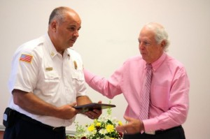 Kevin Spradlin | PeeDeePost.com Rockingham Mayor Steve Morris presents Fire Chief Charles Gardner with a plaque, a token of appreciation for his years of service to the city. Gardner is stepping down, effective Thursday, due to health reasons.