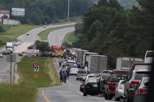 A Chuck Thames photo Traffic backs up on eastbound Highway 74 early Friday afternoon after a tractor-trailer ran into a guardrail and crashed, authorities said.