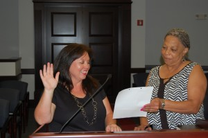 Submitted photo Jan Owens, left, is sworn in by City Clerk Gwendolyn Swinney as the newest patrol officer with the Rockingham Police Department.