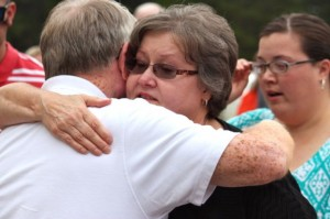 Kevin Spradlin | PeeDeePost.com Nancy Sherrill Robbins, wife of the late Ray Robbins Jr. for 37 years until his death in April 2013, embraces Hoffman Fire and Rescue Chief Frank McKay after a monument in her husband's honor is unveiled at the Marston station.