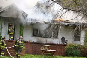 Kevin Spradlin | PeeDeePost.com Firefighters from Cordova Fire and Rescue and Northside Volunteer Fire Department arrived at a home on Cartledge Creek Road with flames shooting out of the living room area.